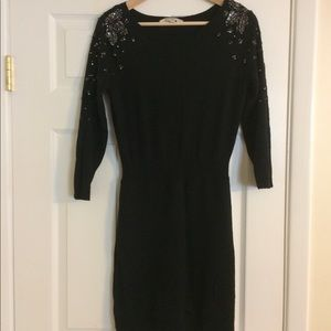 Beautiful fitted sweater dress with sequin detail